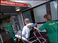 Paramedics take a patient into an Accident and Emergency department
