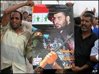 Shia protesters hold poster of Moqtada Sadr