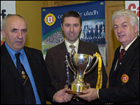 Ulster Council officers Danny Murphy and Miceal Greenan with Dominic McClements