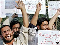 Pakistani students at a protest against the air strike in Lahore