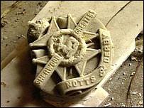 Part of the war memorial in storage