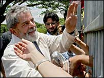 Brazil's President Luiz Inacio Lula da Silva waves to supporters in Brazilia on 30 October 2006