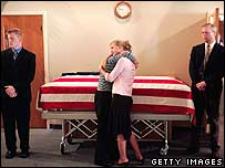 Relatives embrace in front of coffin of US soldier Andrew Patton