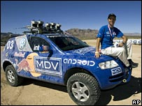One of the robot rally cars and team member Sebastian Thrun