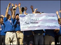 Winning team with a giant cheque
