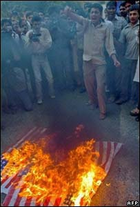 Protesters in Karachi burn a flag in protests against Monday's madrassa raid [31 Oct]