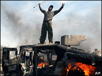 Iraqi dances on top of burning US Humvee