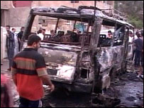 A burnt-out vehicle, part of the wedding party struck in Baghdad