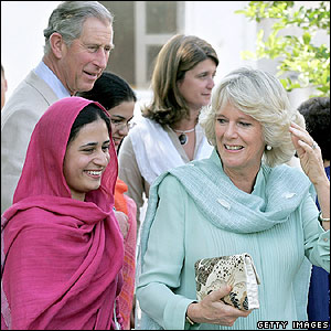 Camilla (left), woman and Camilla, Duchess of Cornwall