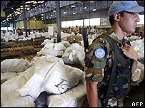 UN soldier guards bags of ballot papers in DR Congo