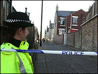 Policewoman near fire scene