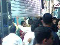 Cairo Eid crowds: Bloggers say the picture shows a shop owner giving shelter to a woman who was assaulted