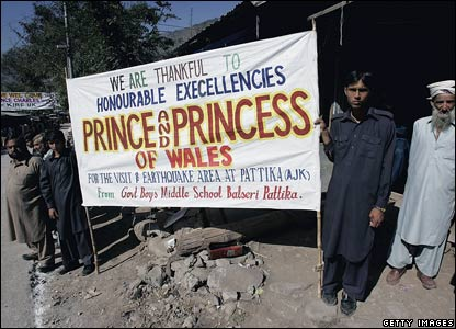 Banners welcome Prince Charles, the Prince of Wales, and his wife Camilla, Duchess of Cornwall, to the village of Pattika in Pakistan-administered Kashmir