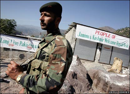 An armed guard in camouflage in the village of Pattika in Pakistan-administered Kashmir