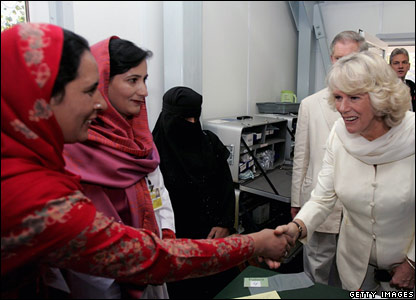 Camilla, Duchess of Cornwall, meets workers in a new Red Cross health clinic paid for by aid in Pattika in Pakistan-administered Kashmir
