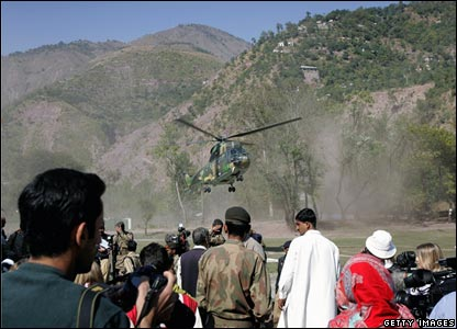 An army helicopter arrives in the mountainous village of Pattika in Pakistan-administered Kashmir