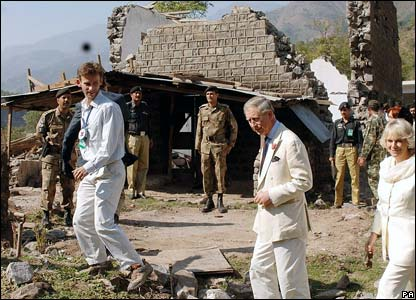 Prince Charles, the Prince of Wales, and his wife Camilla, Duchess of Cornwall, tour the shattered ruins of their houses in the village of Pattika in Pakistan-administered Kashmir