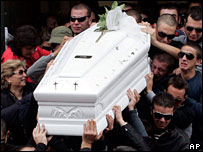 Relatives carry the coffin of Daniele Del Core, one of seven people killed in the last five days