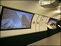 Advertisements projected on walls in the mock Tube station