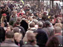 A crowd of people walking in a British high street