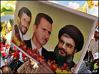 Image of Hezbollah leader, Iranian and Syrian presidents, held up at Hezbollah rally in Beirut
