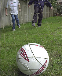 Teenagers play football