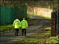 Police officers patrol the Clyde walkway where Kriss was found