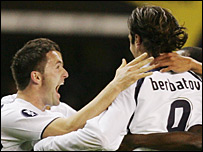 Tottenham goalscorer Dimitar Berbatov is congratulated by his team-mates