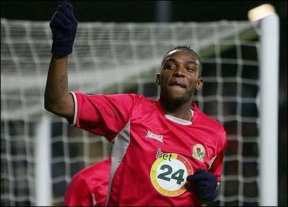 Benni McCarthy celebrates after scoring Blackburn's third