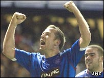 Charlie Adam celebrates scoring Rangers' second goal