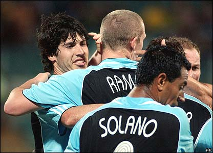 Albert Luque is mobbed by his Newcastle team-mates