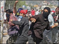 Protestors throw stones during clashes with police in Oaxaca, Mexico, 2 Nov