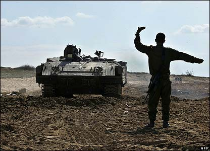 Israeli soldier and armoured personnel carrier near the Gaza Strip