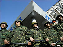 Troops guard the state television building in Bishkek