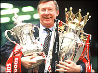 Sir Alex Ferguson with his FA Cup and Premiership trophies in 1996
