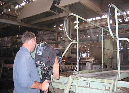 Panorama cameraman Stephen Foote at work in the ISKRA glass factory, Lvov, western Ukraine