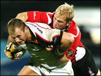 Ulster's Roger Wilson is tackled by Borders opponent Andy Millar