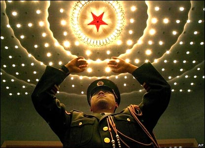 A Chinese military band conductor rehearses at the Great Hall of the People in Beijing, China