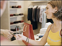 A woman paying for something in a shop