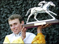 Ryan Moore with his champion jockey's trophy