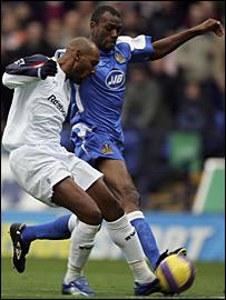 Bolton's Nicolas Anelka tussles with Wigan's Emerson Boyce