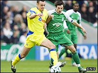 Ivan Sproule and Ryan O'Leary battle for possession at Easter Road