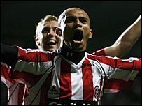 Danny Webber celebrates his winner at Newcastle