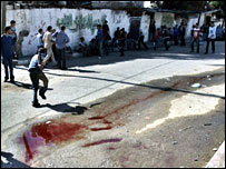 Blood mixed with water in a street in Beit Hanoun