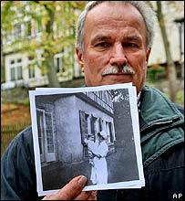 A former Lebensborn child holds up a picture of his past