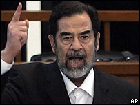 Saddam Hussein in court as the verdict was being read