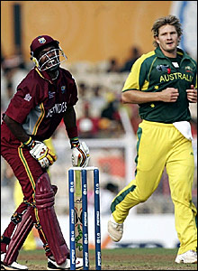 Dwayne Bravo (left) winces after being struck by a Shane Watson delivery