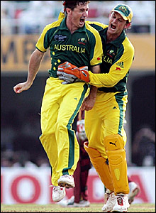 Bradd Hogg (left) and Adam Gilchrist celebrate taking the wicket of Dwayne Bravo