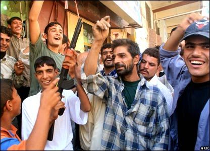 Young men in Basra celebrate the guilty verdict