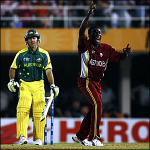 Ricky Ponting (left) departs as Jerome Taylor celebrates